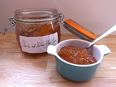 Vanilla and yellow plum jam in a pot and the jar