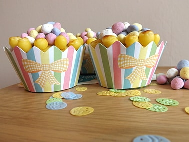 2 simnel cupcakes with mini chocolate eggs for decoration
