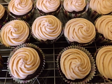 cupcakes frosted on the cooling rack