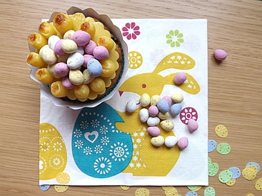 simnel cupcake decorated with mini eggs