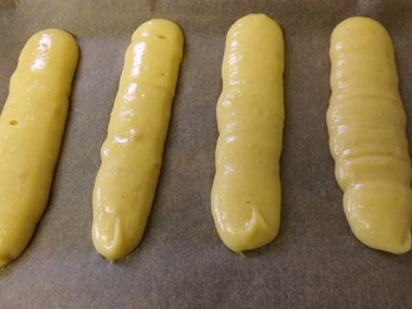 eclairs piped on the tray ready to be baked