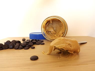 A jar of peanut butter and chocolate chips