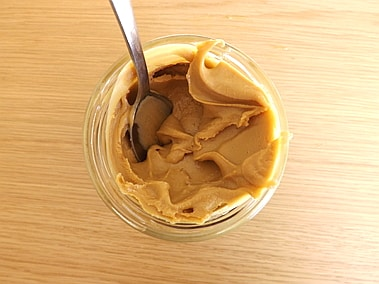 An open jar of peanut butter