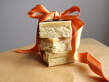 3 ginger slices stacked and tied with an orange bow