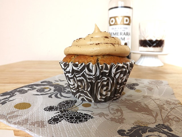 rum banana and coffee cupcake with a bottle of dark rum