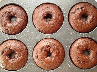 baked doughnuts cooling in their tin