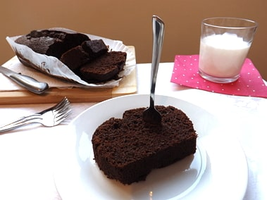 a slice of chocolate and coffee cake with a glass of milk