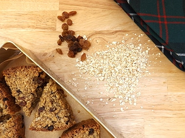 flapjacks in a tin with rolled oats and sultanas with a tartan tie