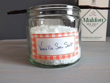 vanilla sea salt with a box of sea salt and a vanilla pod