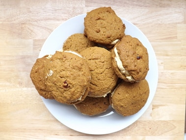 a plate of pumpkin whoopie pies from above