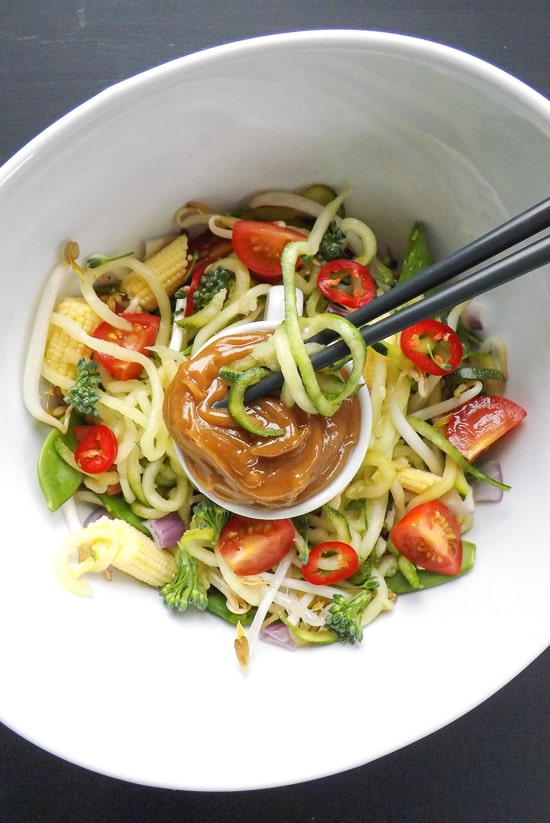Peanut Butter Sauce Zucchini Noodle Salad - Enjoying the dipping sauce | BakeThenEat.com