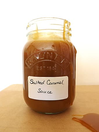 salted caramel sauce dripping down the jar