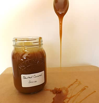 salted caramel sauce dripping from a spoon