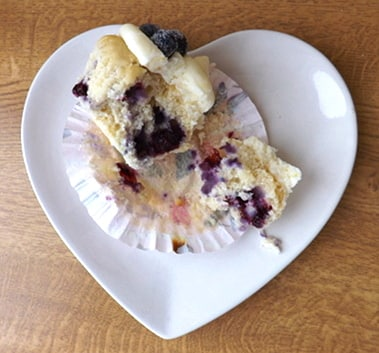 lemon and blueberry cupcake broken open