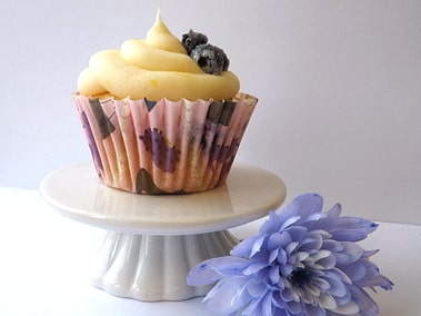 Lemon and blueberry cupcake next to a flower