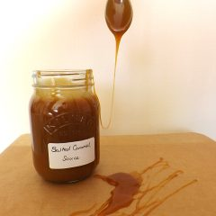 salted caramel sauce with a spoon dipped in it