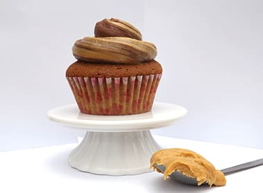 Peanut butter cupcakes with a spoonful of peanut butter | BakeThenEat.com