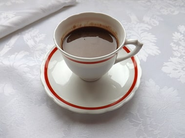 plain hot chocolate in a cup and saucer