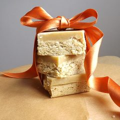Stacked ginger slices tied up with an orange ribbon.