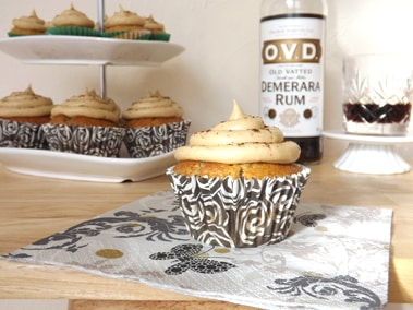 cupcakes on a cake stand next to a bottle of OVD dark rum
