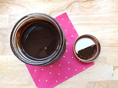 an open jar of homemade chocolate syrup