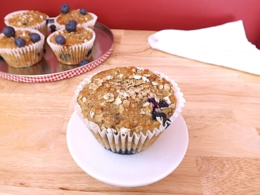Close up of a skinny banana and blueberry muffin