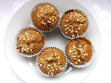 overhead shot of a plate of banana nut and caramel muffins