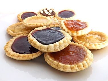 a big pile of jam tarts