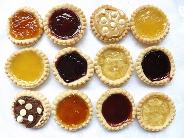 four rows of jam tarts all lined up