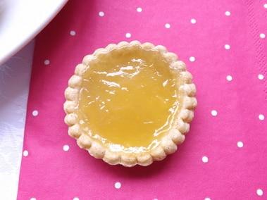 a lemon curd tart on a pink napkin