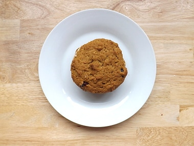 a pumpkin whoopie pie on a plate shot from above