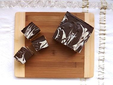 millionaires caramel shortcake chopped up on a board