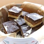 millionaires caramel shortcake cut up and in a tin