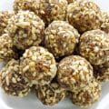 Plate of Healthy Lemon Poppy Seed Nutty Date Energy Bites | BakeThenEat.com