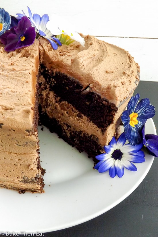 A slice out of a Chocolate Fudge Cake with Nutella Frosting | BakeThenEat.com