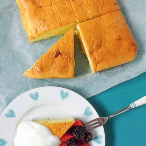 Light Airy Orange Lemon Snack Cake Served With Berries |BakeThenEat.com