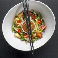 Peanut Butter Sauce Zucchini Noodle Salad With Chop Sticks | BakeThenEat.com