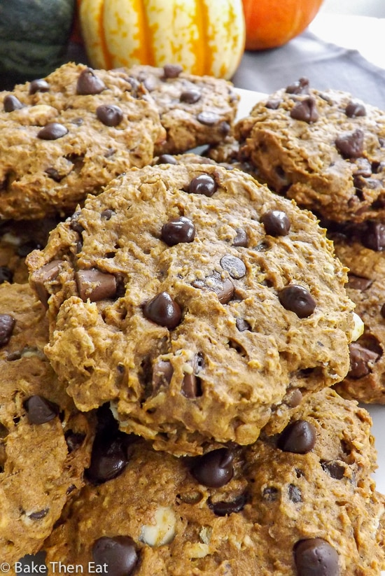 Breakfast Chocolate Chip Pumpkin Oatmeal Cookies piled on a plate | BakeThenEat.com