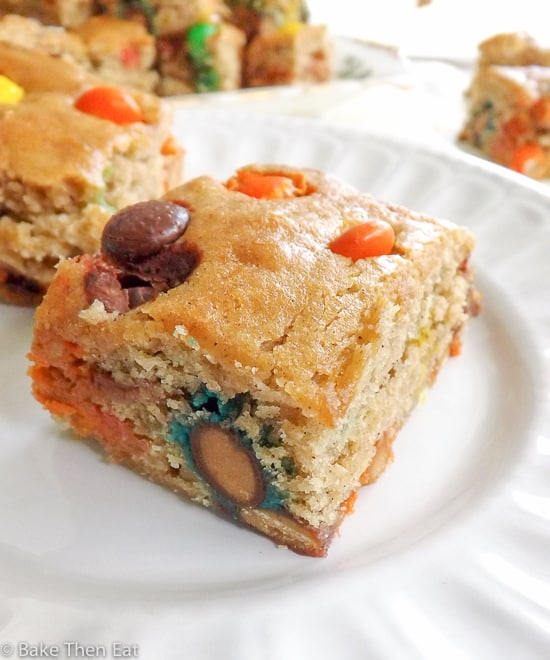 Overloaded Peanut Butter Candy Stuffed Blondies | BakeThenEat.com