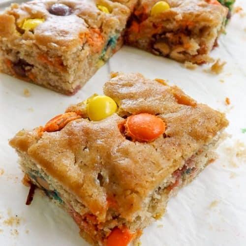 Overloaded Peanut Butter Candy Stuffed Blondies | BakeThenEat.com