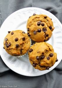 Sweet Potato Chocolate Chip Peanut Butter Muffins are a great way to sneak some veggies into breakfast. Sweet, dense, nutty and a little bit chocolaty. Easy recipe to follow. | BakeThenEat.com