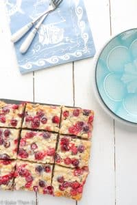 White Chocolate Gooey Fresh Cranberry Bars are an easy to follow recipe, packed full of all the flavours of the festive season. Fresh cranberries, white chocolate and ginger. Gooey and delicious these make a perfect festive treat   BakeThenEat.com