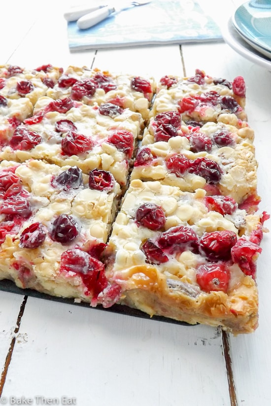 White Chocolate Gooey Fresh Cranberry Bars are an easy to follow recipe, packed full of all the flavours of the festive season. Fresh cranberries, white chocolate and ginger. Gooey and delicious these make a perfect festive treat | BakeThenEat.com
