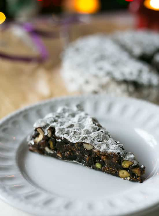 Gluten Free Vegan Italian Chocolate Panforte is an easy to make Italian Christmas cake. Packed full of nuts, dried fruits and sweet spices and a little bit of dark chocolate. Easy recipe to follow and only a few ingredients needed. Adapted to be Vegan and Gluten Free | BakeThenEat.com