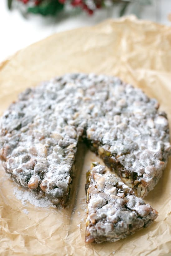 Traditional Italian Honey Panforte, is a traditional Italian dessert. Packed full of figs, apricots and nuts and baked in honey and sugar | BakeThenEat.com