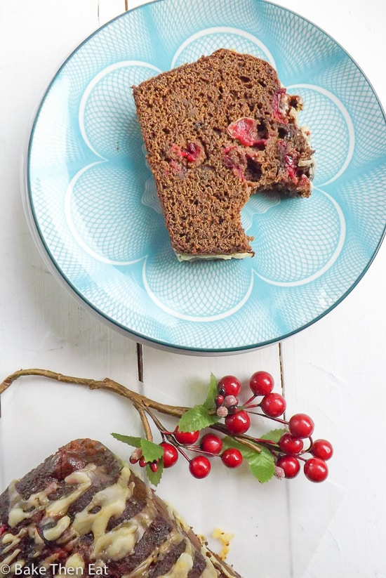 Orange Glazed Fresh Cranberry Gingerbread is a simple gingerbread recipe to follow. It has a dark gingery molasses flavour to it. The fresh cranberries are bursting with flavour and the sweet simple orange glaze bring all the flavours together. | BakeThenEat.com