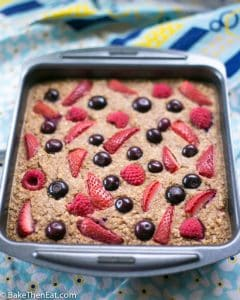 A tin of Healthy Baked Berry Oatmeal | BakeThenEat.com