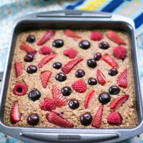 A tin of Healthy Baked Berry Oatmeal   BakeThenEat.com