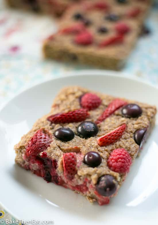 A slice of Healthy Baked Mixed Berry Oatmeal | BakeThenEat.com