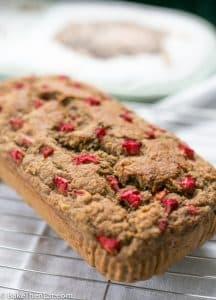 A loaf of Healthy Sugar Free Rhubarb Banana Bread | BakeThenEat.com